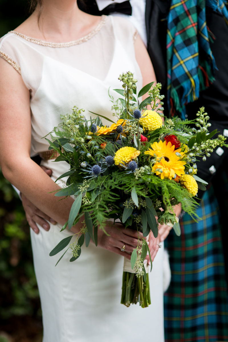 Scottish Themed Wedding with Burgundy, Navy, and Copper | Wildflower Bride's Bouquet with Groom's Kilt