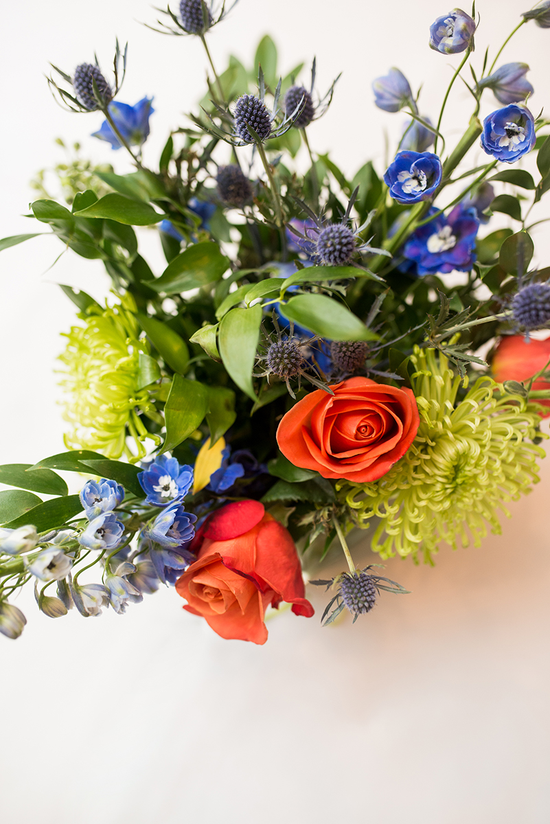 Scottish Themed Wedding with Burgundy, Navy, and Copper | Wedding Centerpiece with Blue Thistle and Crab Roses