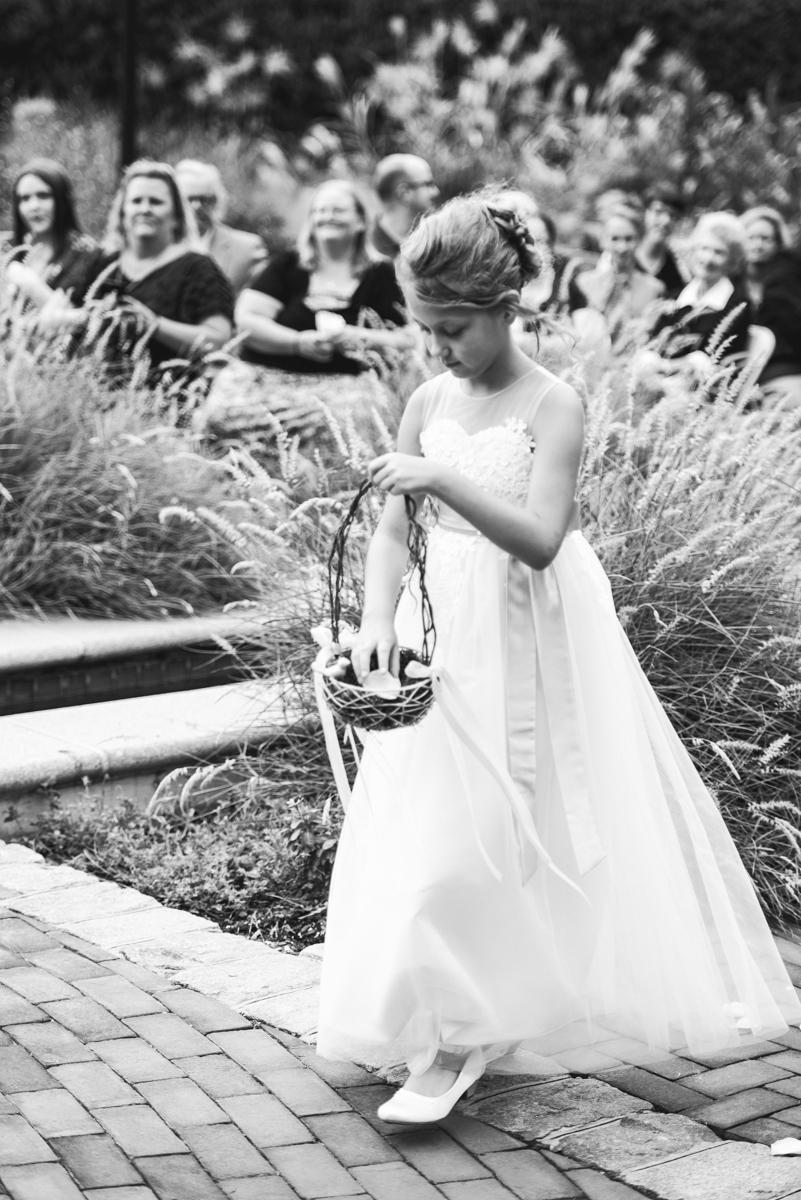 Blush and Burgundy Garden Wedding | Flower girl walking down the aisle