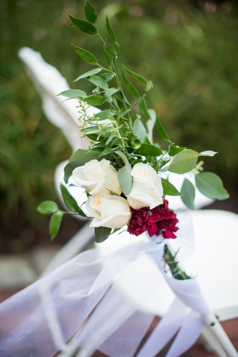 Blush and Burgundy Garden Wedding | Blush and white flower ceremony chair decoration