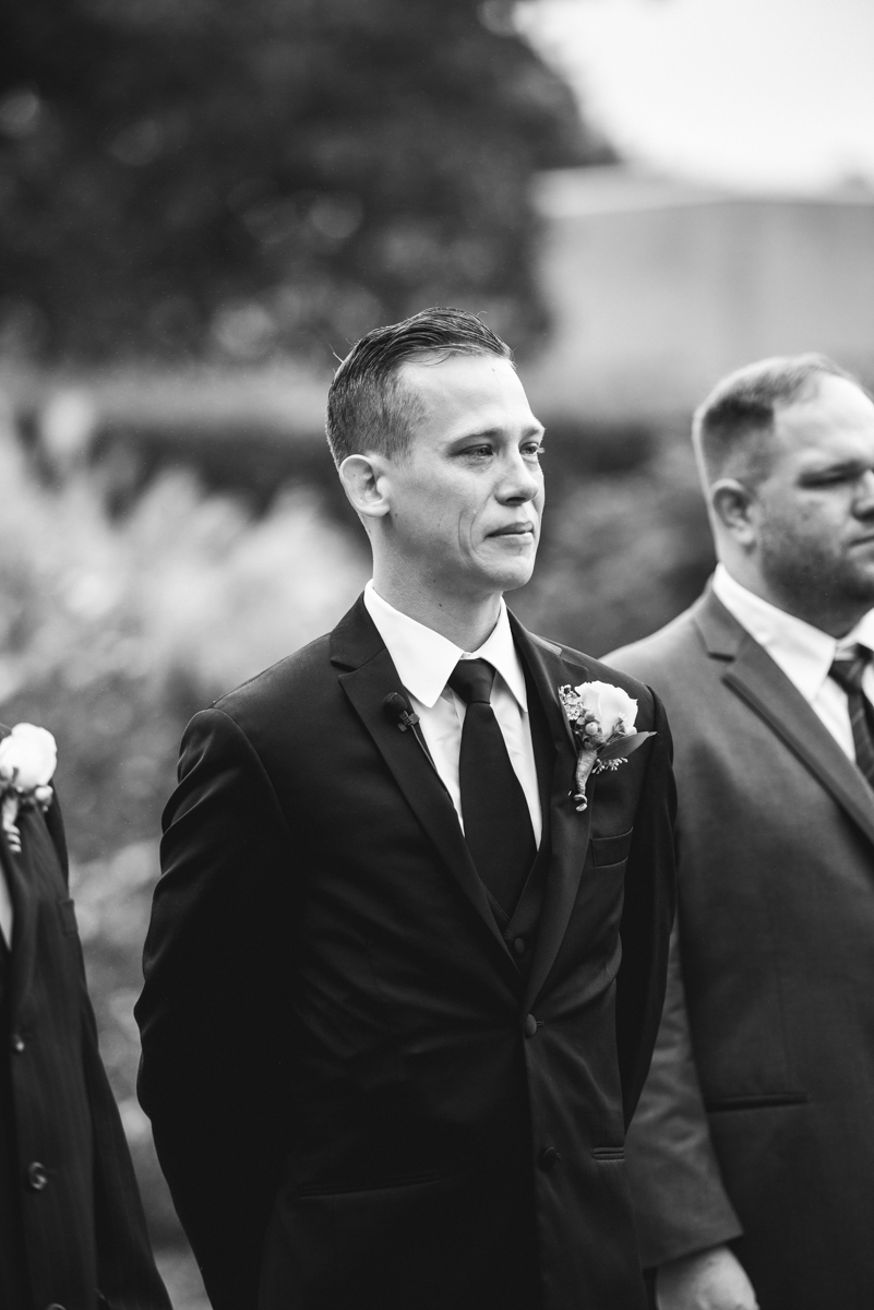 Blush and Burgundy Garden Wedding | Groom watches his bride walk down the aisle