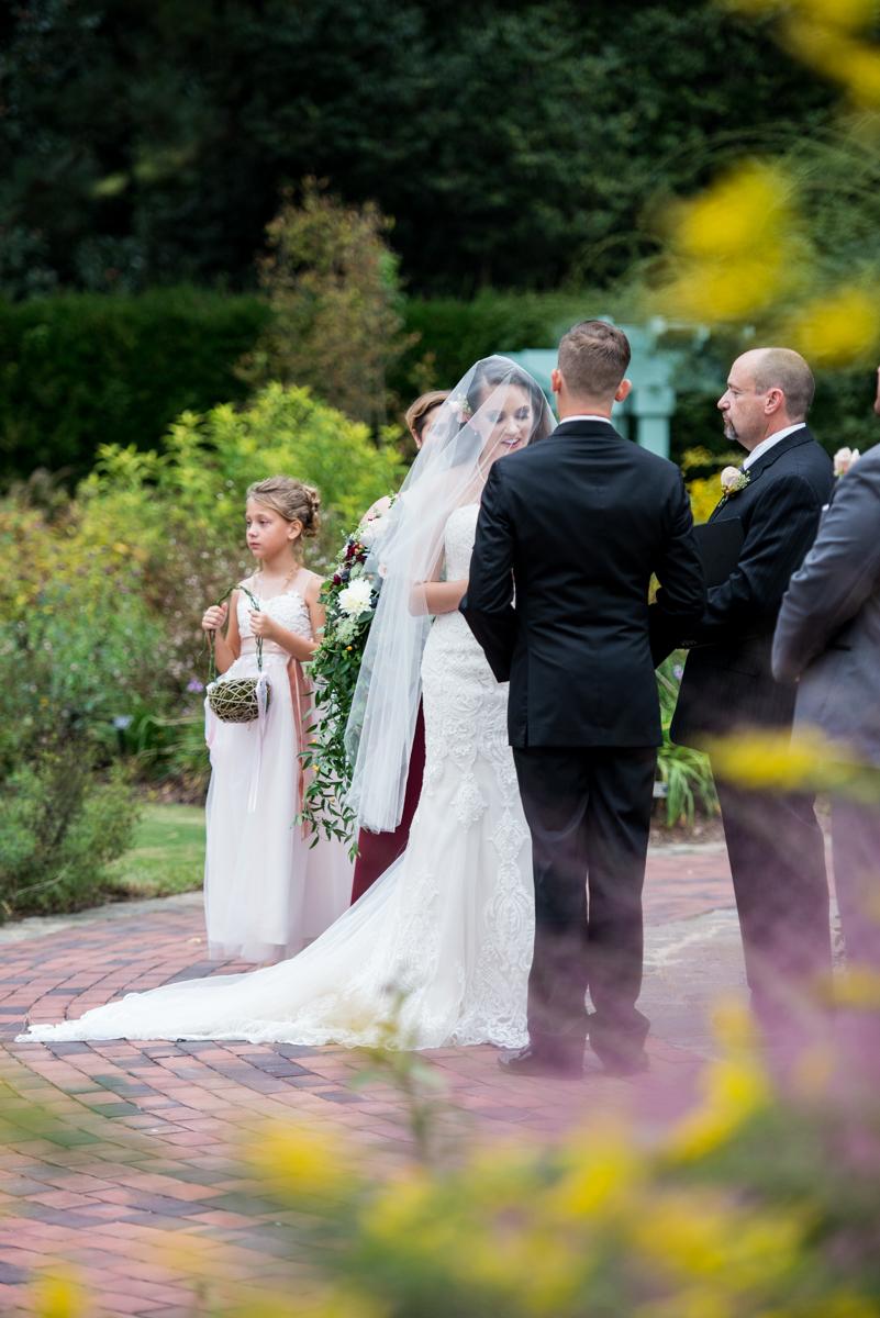 Blush and Burgundy Garden Wedding | Outdoor fountain wedding ceremony