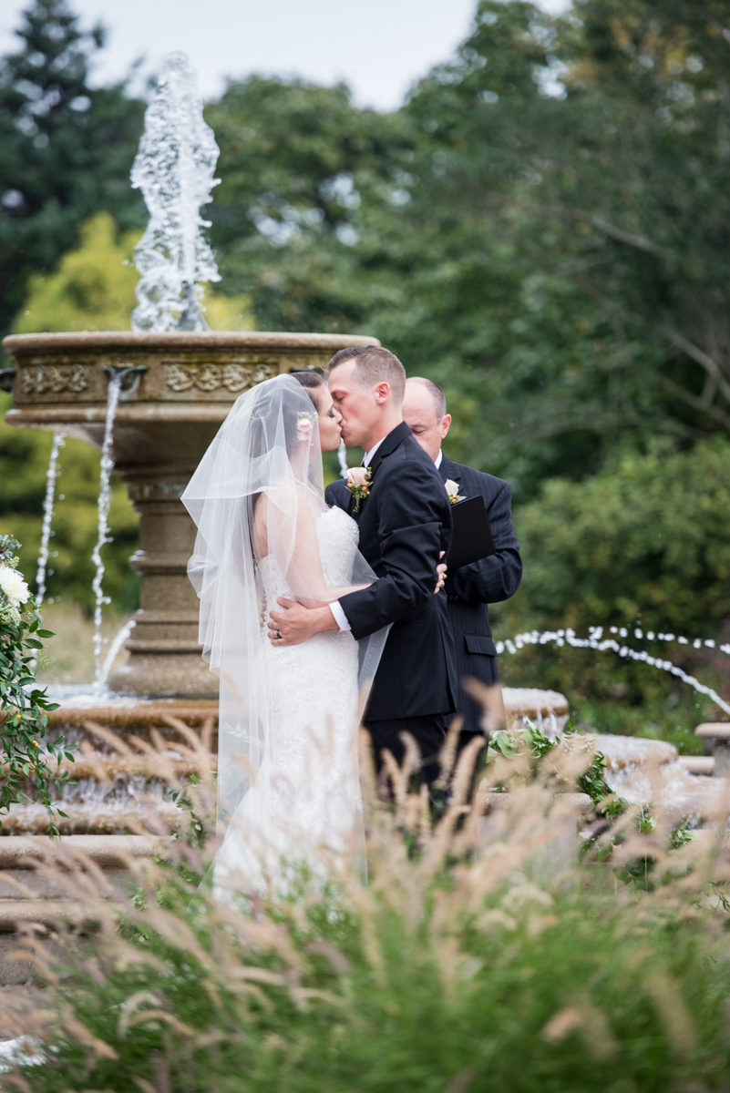 Blush and Burgundy Garden Wedding | Bride and groom first kiss