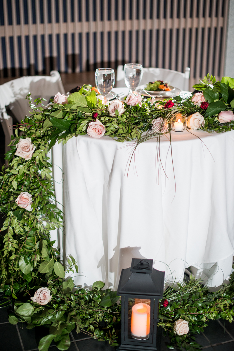 Blush and Burgundy Garden Wedding | Head table with rose garland