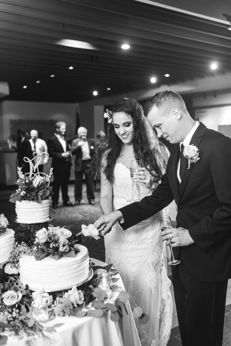 Blush and Burgundy Garden Wedding | Cake cutting