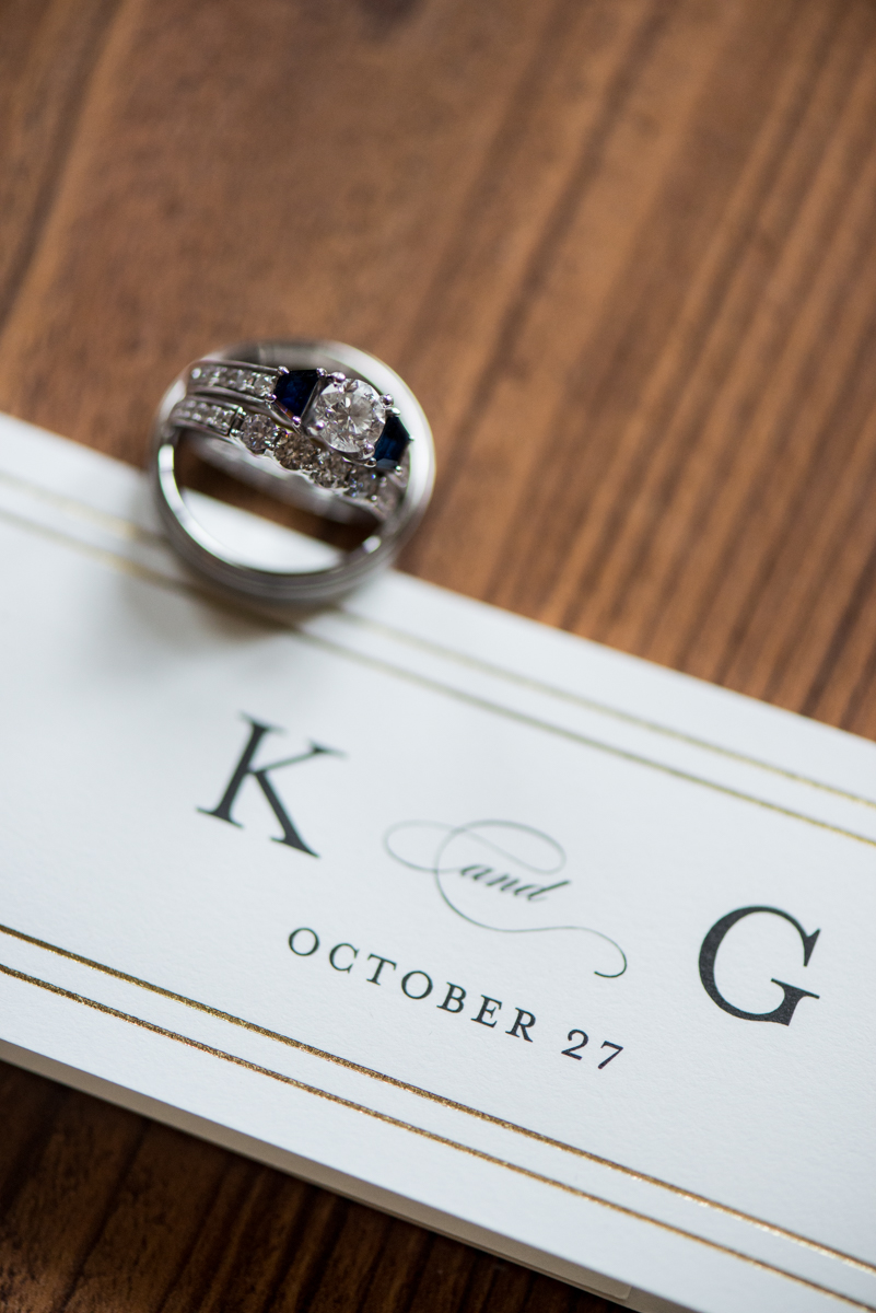Gold, Blue, and Burgundy Fall Wedding | Invitation Wedding Ring Shot