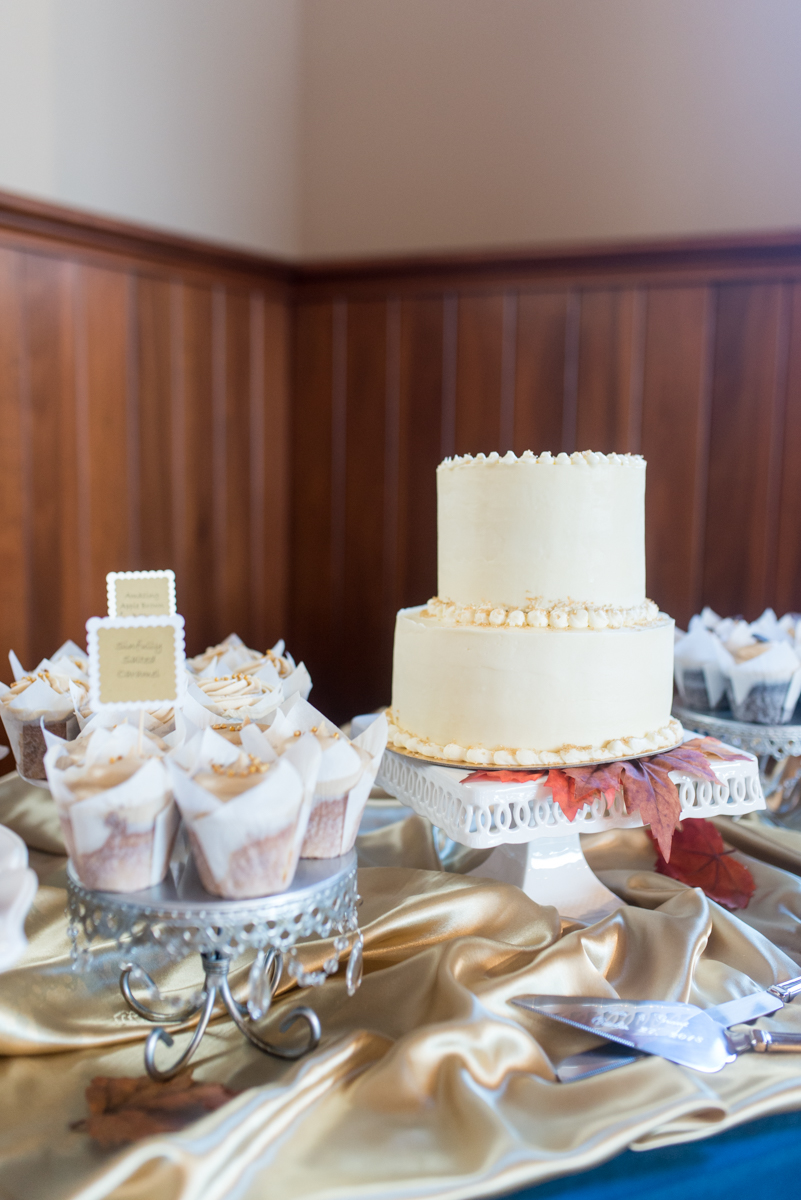 Gold, Blue, and Burgundy Fall Wedding | White wedding cake and dessert bar
