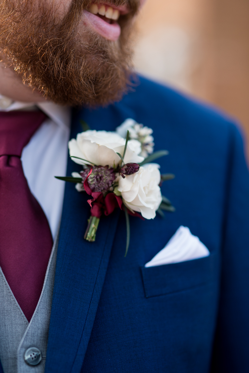 Burgundy and Pale Blue Winter Wedding |White and burgundy boutonniere