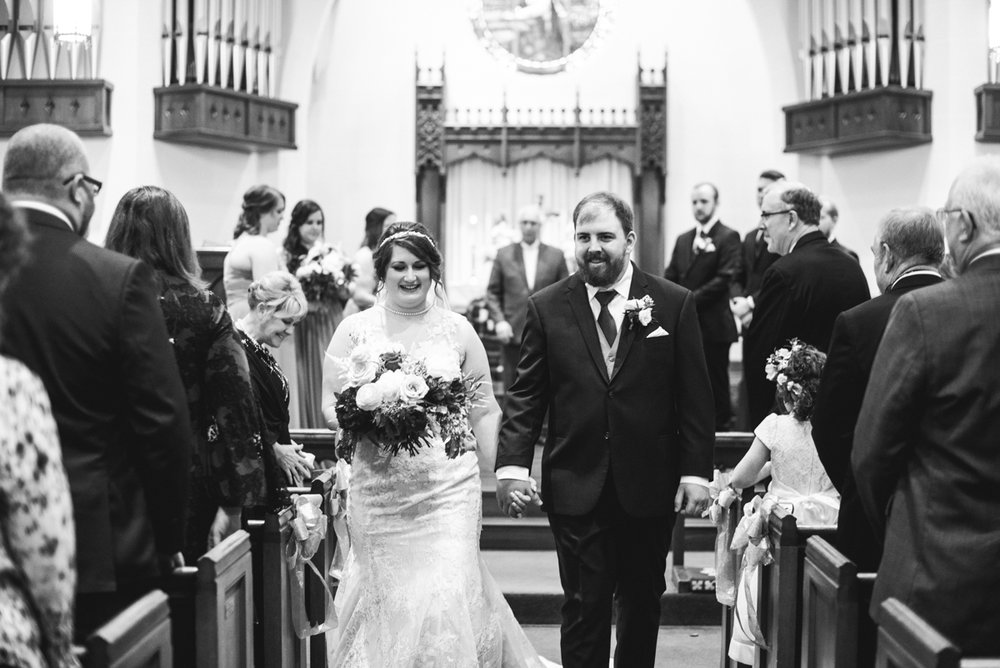 Burgundy and Pale Blue Winter Wedding | Bride and groom recessional