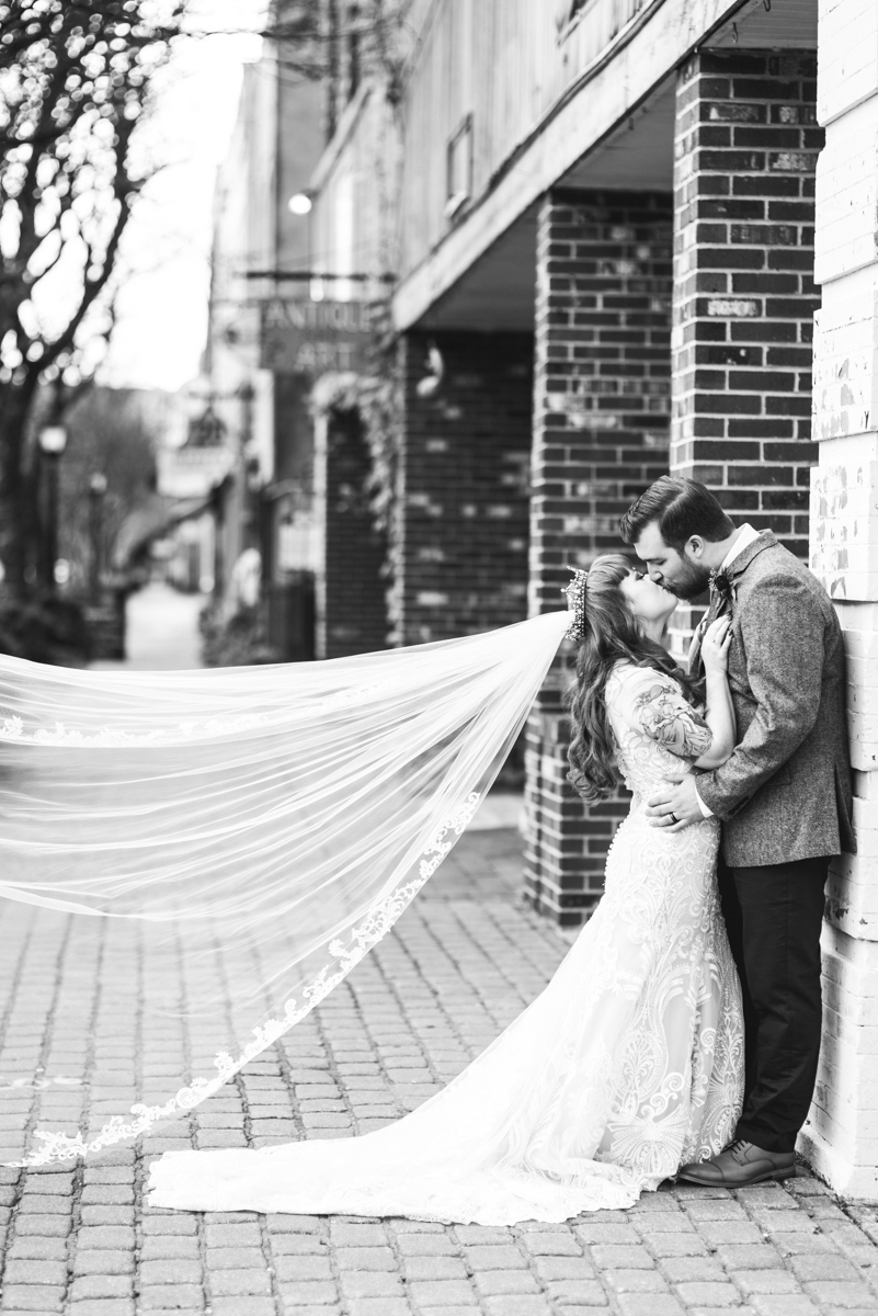 Vintage Winter Wedding with Red and Gray | Bride and Groom Portraits with Cathedral Veil