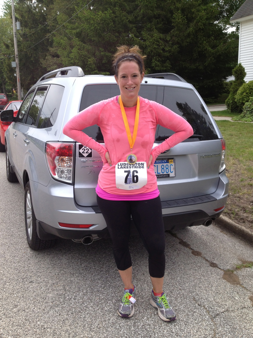Immediately after finishing the Ludington Lakestride Half Marathon this June, a race I've run 5 times now and love more and more each time I run it.  Photo credit: my mom.