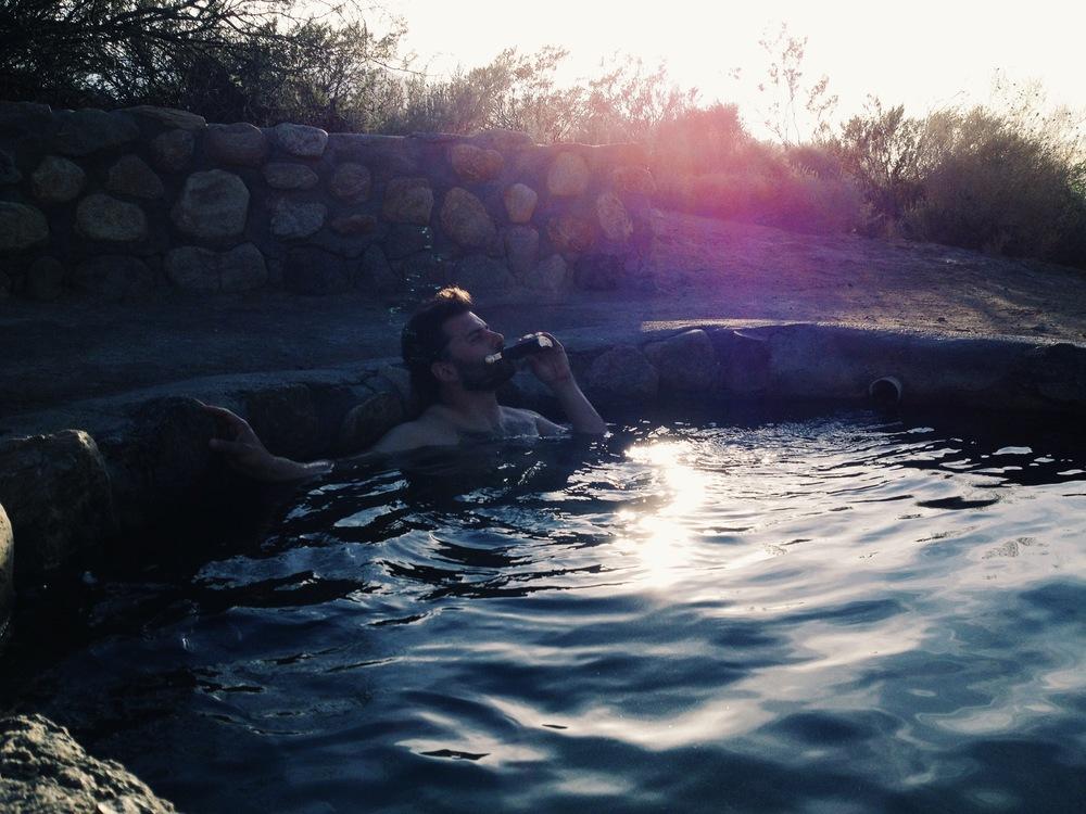 Ian enjoys the natural hot tub and his Christmas flask at Roper Lake State Park.