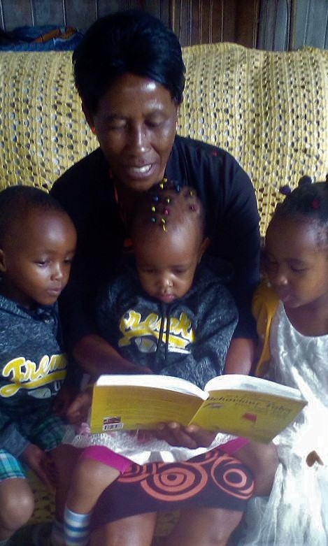 Katunge and grandchildren with A-Z book.jpg