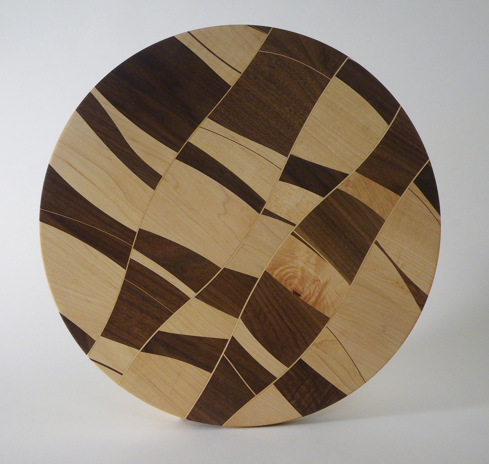 "Chaos Board. These are one-of-a-kind. Diameter sizes vary, 18""-23"". Best as display or serving pieces."