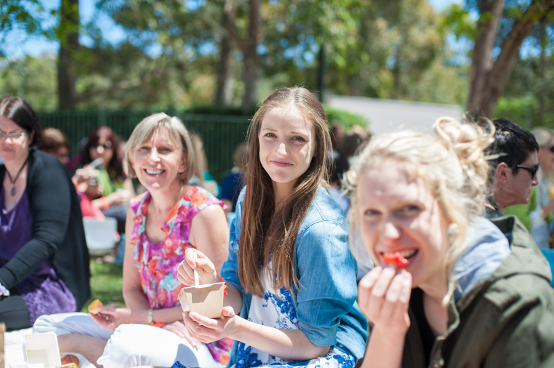 Enjoying the sunshine and food together between sessions