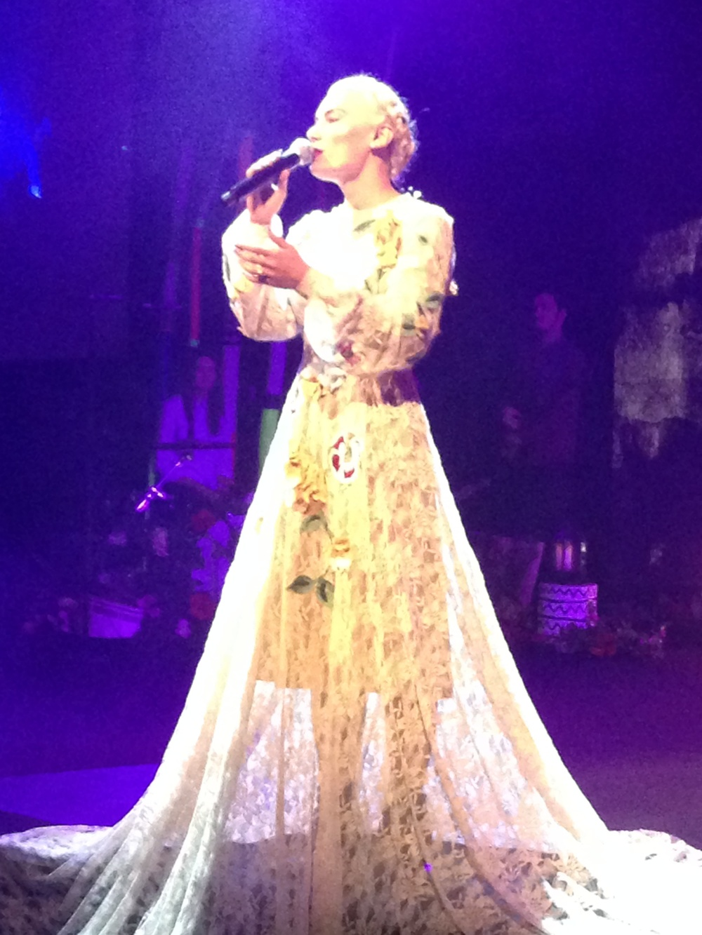 Amy Rose adorned in an elaborate handcrafted gown custom designed by Jacinta Warner
