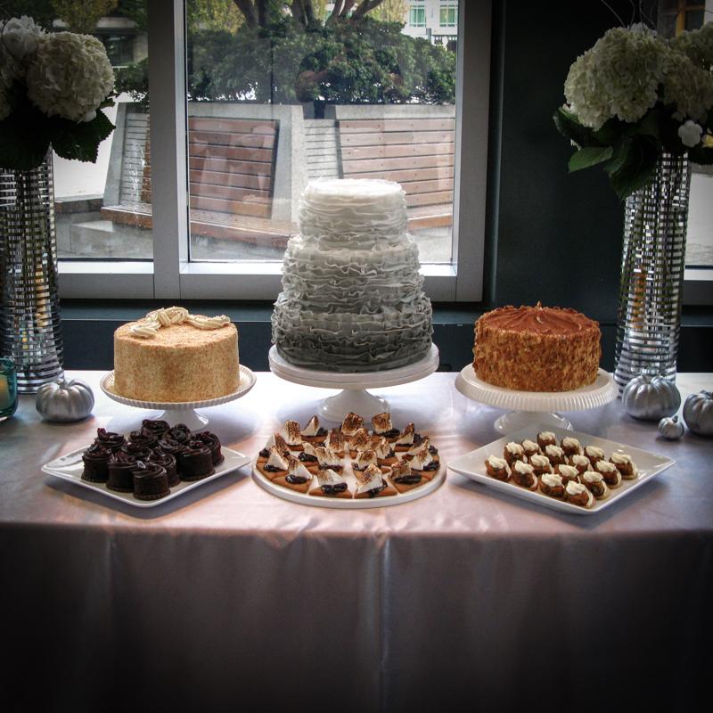 Tiered ruffled fondant ombré cake, tiramisu, coconut cream cake, assorted dessert canapés