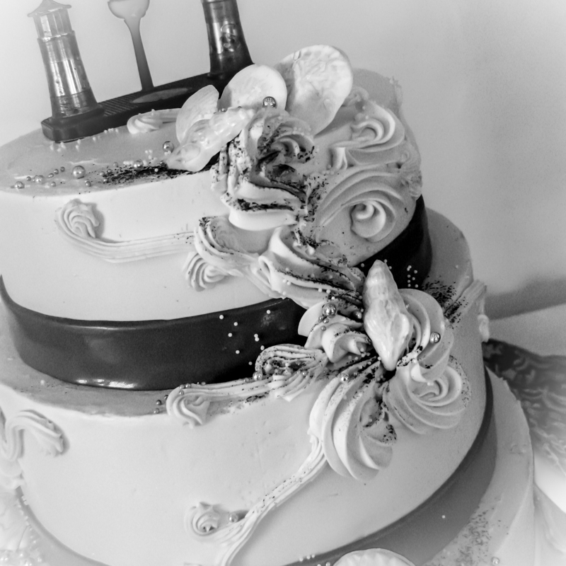 Chocolate cherry red wine cake, lavender sponge with blueberry lavender filling; piped scrollwork, buttercream finish