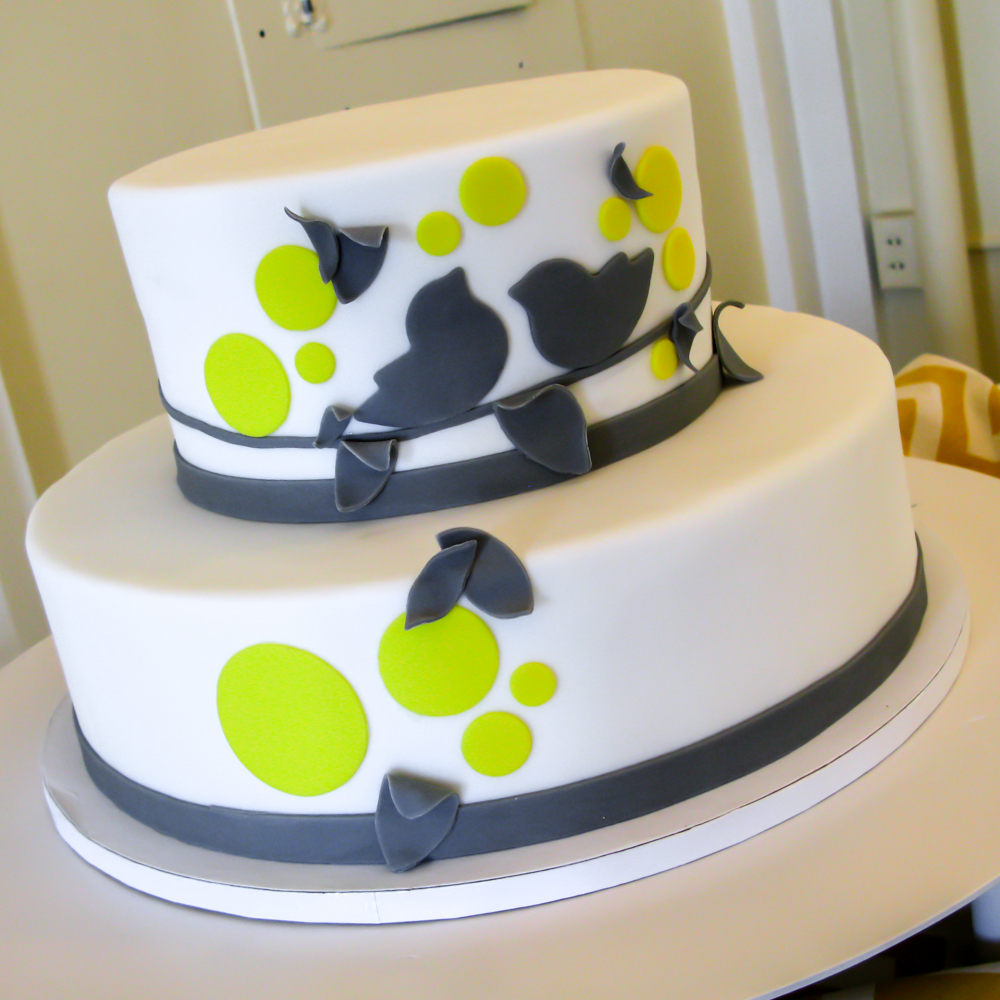 Lemon sponge cake with lemon curd; fondant finish, graphic bird motif