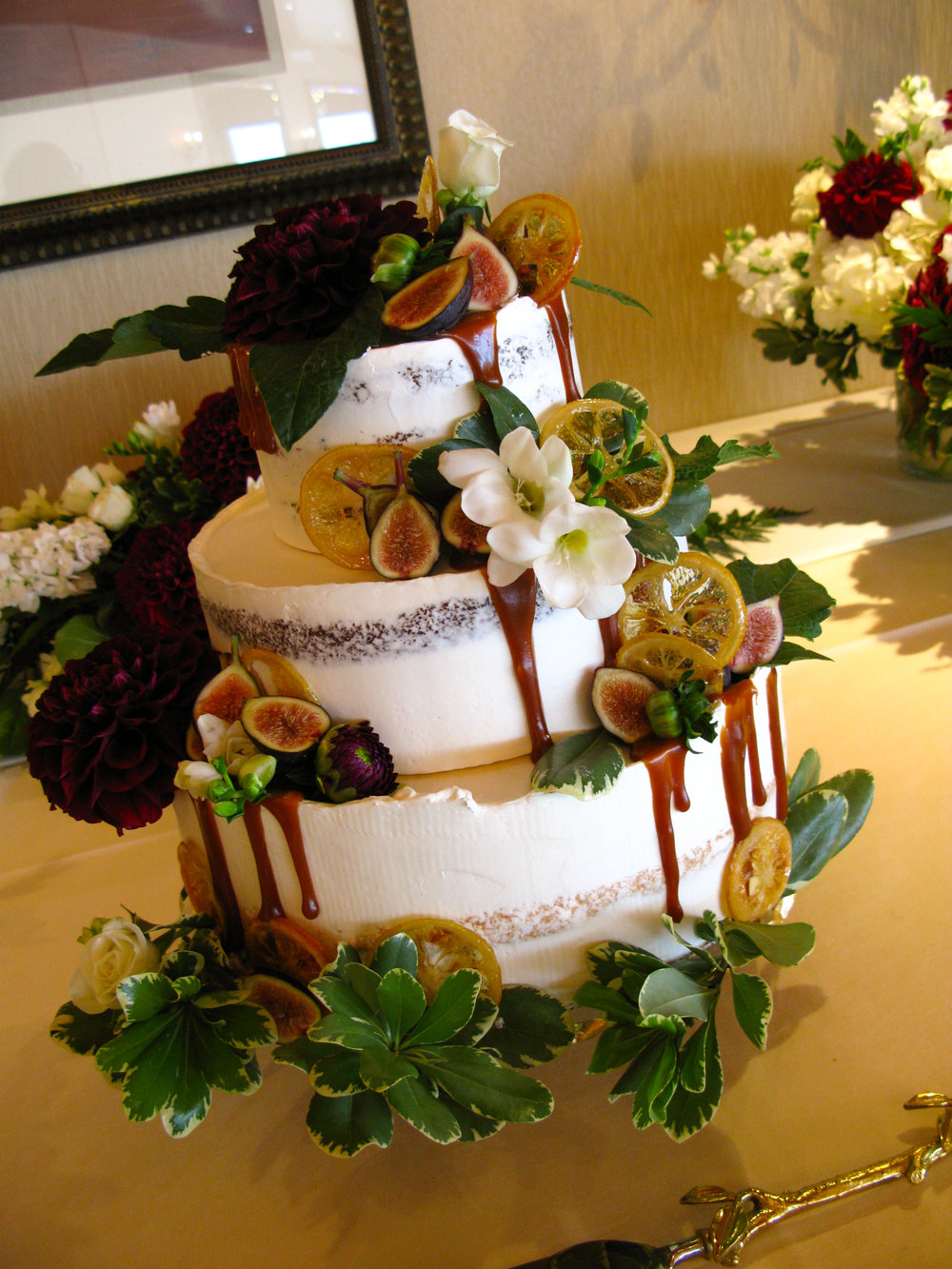 Carrot cake, chocolate cake, lemon cake with blackberries; decorated with candied lemon and figs