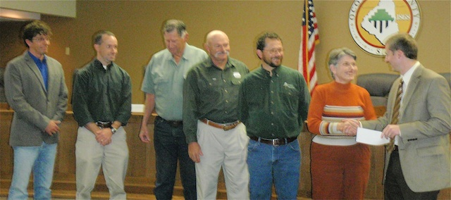 Shea Airey, far right, chairman of the Oconee County Conservation Bank, accepts a $1,200 donation from Oconee Forever's Alice Wald, second from right, at OCCB's December 6 meeting.  Other Conservation Bank members present were: left to right, Andy Lee, Rocky Nation, Lynn Harwell, Ed Land, Marvin Prater.