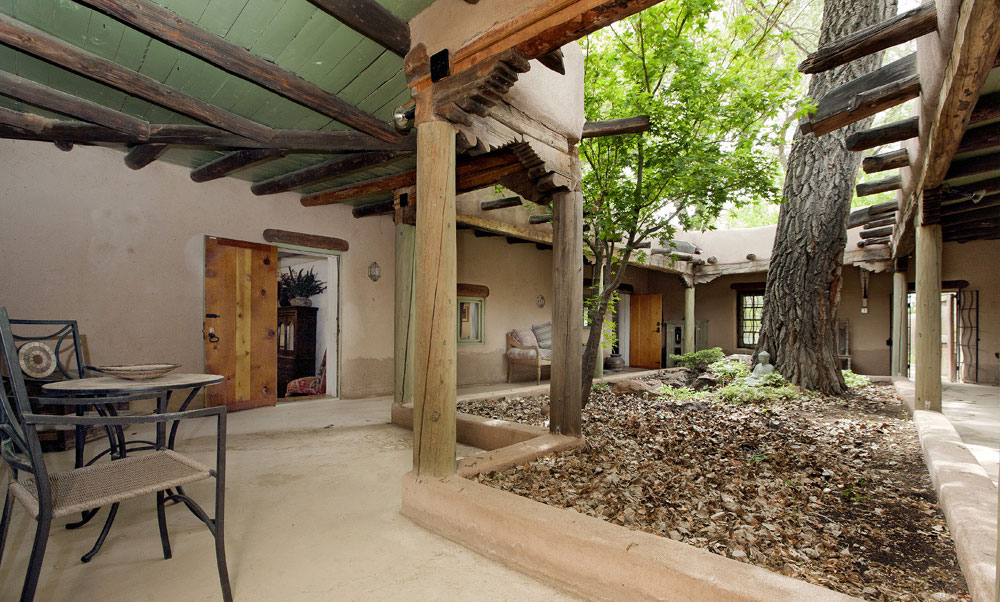 Saint Teresa House   SOLD      Dreamcatcher Real Estate Co MAIN HOUSE   Turn the key to the door of this home  and unlock not just entry to a Classic Pueblo style residence but to an architectural experience of