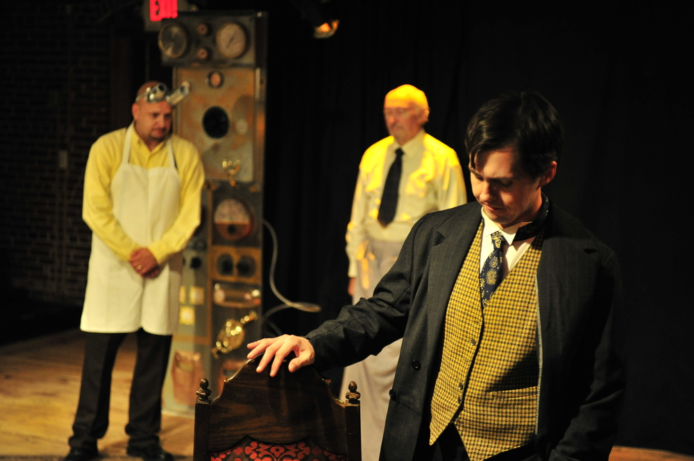 "Photo of The Players' Ring stage production of ""Pancakes"" by  P.T. Sullivan , featuring David Kelley as The Attendant, Chuck Galle as Mr. Roberts, and E. Christopher Clark as Charlie."