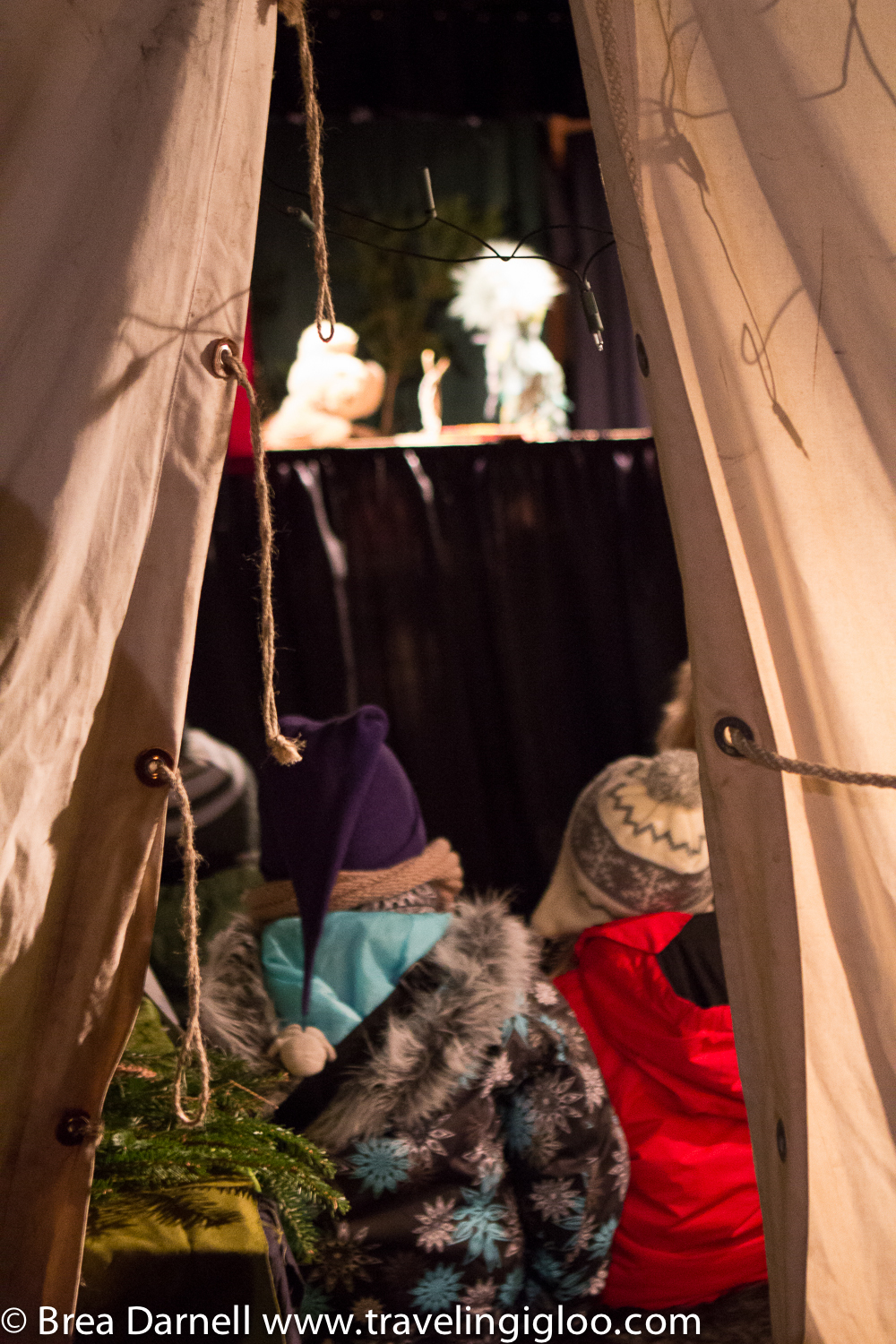 I love this image. Children were listening to Christmas stories inside the tent.