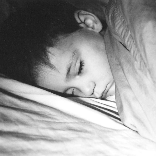 Fifteen years ago, pretty much to the minute, I took this photo of my oldest son. On this morning the day before he turned 5, I was walking past his room early in the morning and saw the sun across his face like this, highlighting the last of the baby pout, round cheeks and glorious eyelashes. I ran for my camera, thankful it had film in it, and shot two frames before he woke up with the noise of the shutter. This photo has been one of my most treasured possessions 💕 Today this boy is about to turn 20, this is his last day being a teenager (!) and this photo means even more today than it did then. As photos tend to do 😊