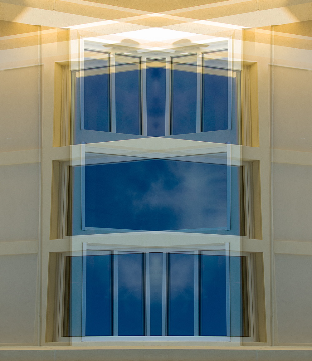 Windows reflecting sky that are duplicated, rotated and layered. Reminds me of an altar of some kind.