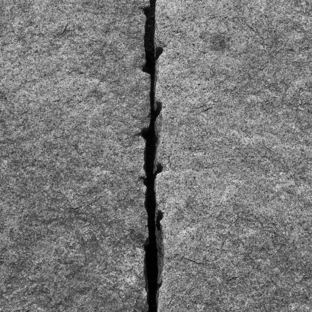 The seam between the granite blocks.