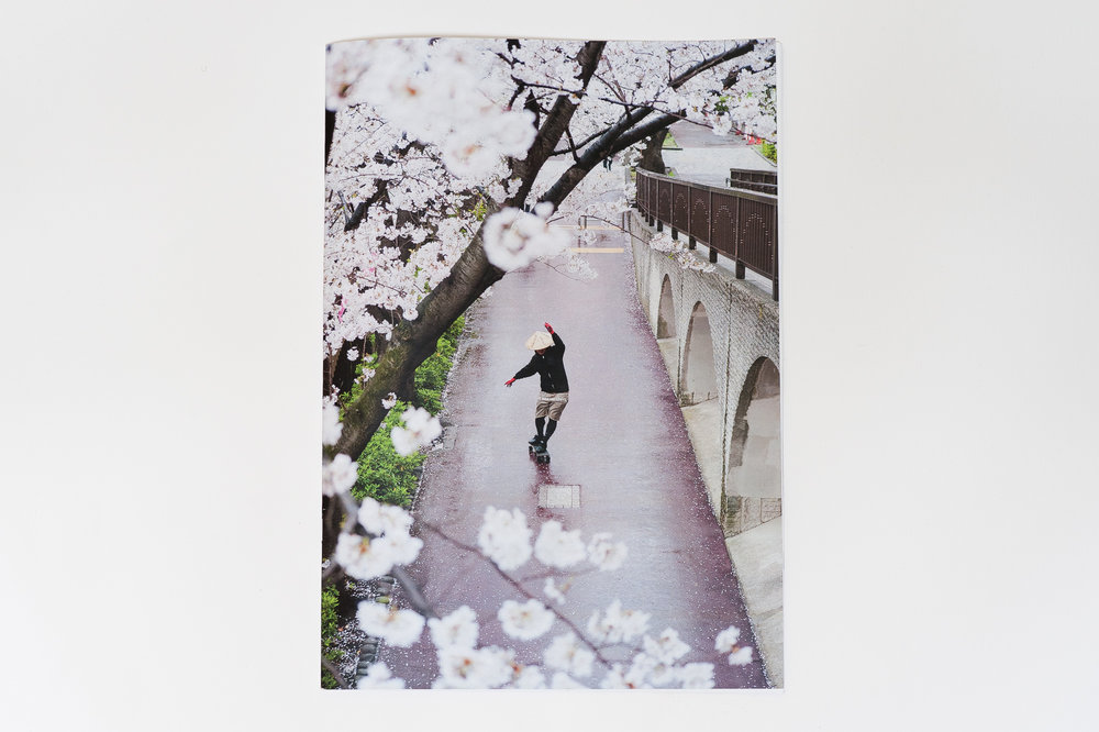 """""""SAKURA""""(the Japanese word for cherry blossom), is a zine featuring Japanese skateboarding legend, Takahiro Morita. Photographed in Tokyo during the short two week period in which the flowers are in full bloom, """"SAKURA"""" captures the spirit and cultural significance of the cherry blossoms and explores how skateboarding interacts with the flower filled cityscape. Designed by Mike Sikora, and published by the Milk Gallery at Milk Studios, New York. Copies available for purchase at  Theories of Atlantis Distribution . Watch the accompanying short film produced by Far East Skate Network  here ."""