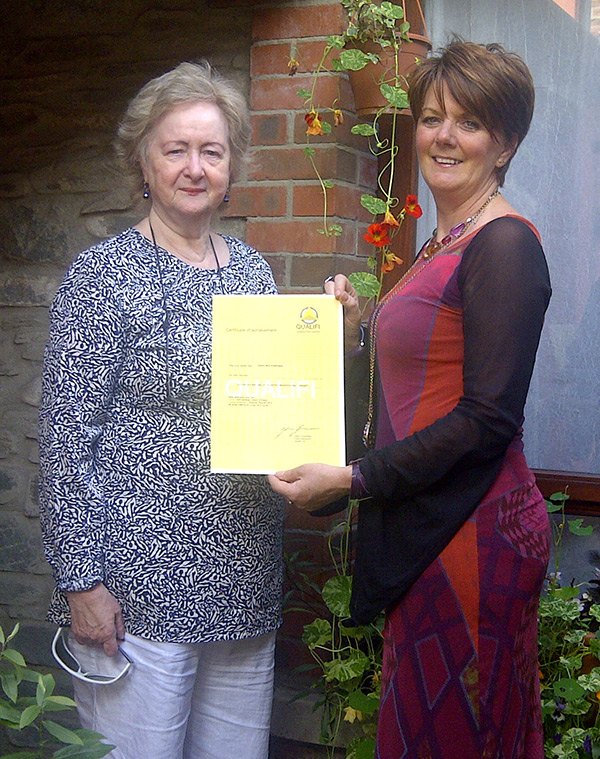 Noella McConnelleague, Director of ZEST, receiving her Advanced Diploma in CBT from Dr Helena Schlindwein Ph.D. FNCP Director of CHATS.