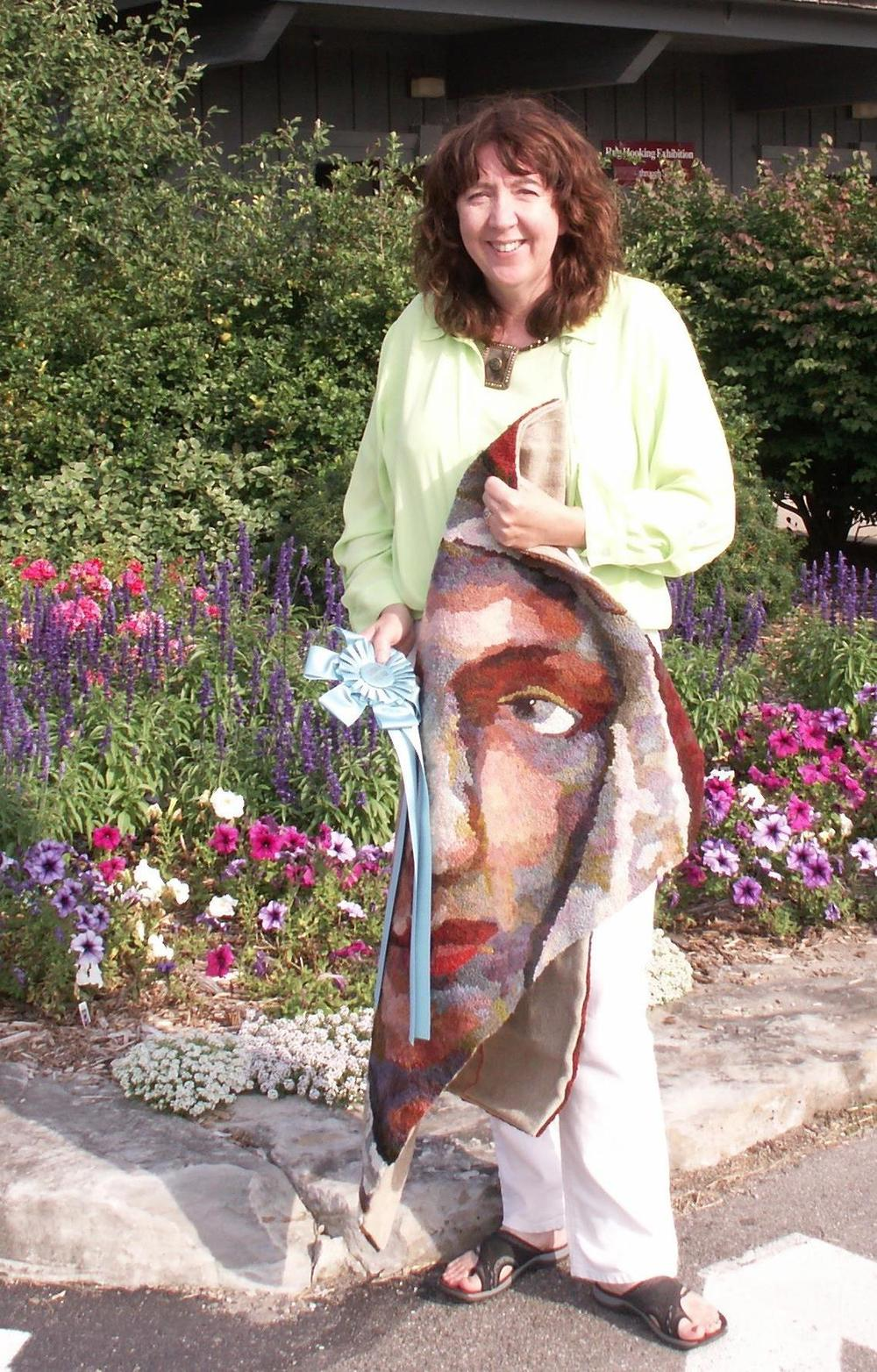 Me in front of Sauder Village 2013 with Mary Magdalene rug and People's Choice Ribbon.