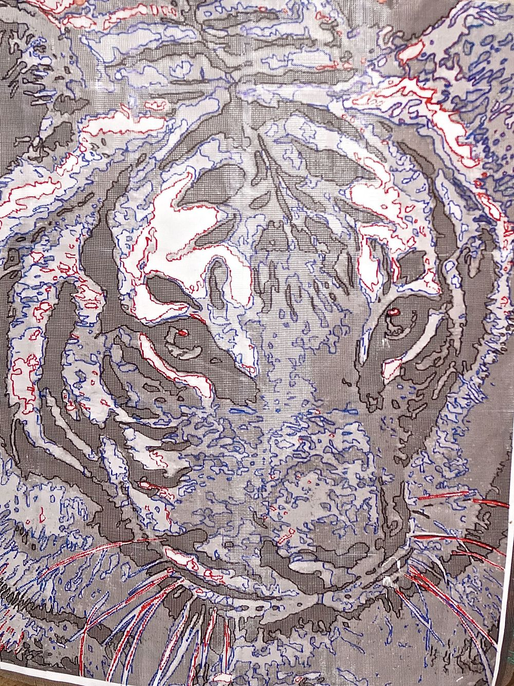 Satu the Tiger traced on grid fabric
