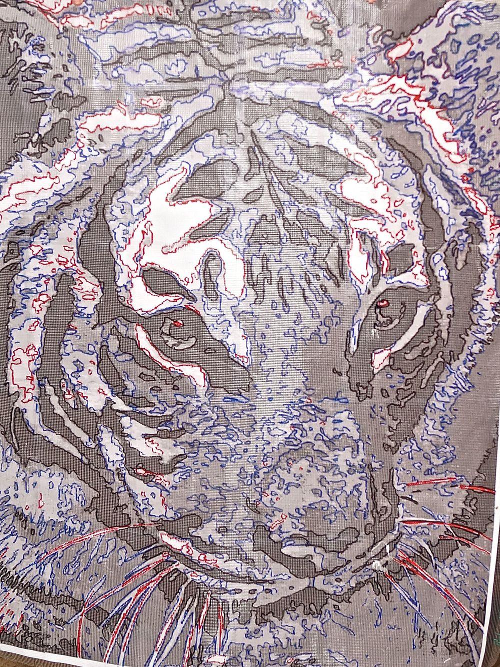 Satu the Tiger traced on grid fabric