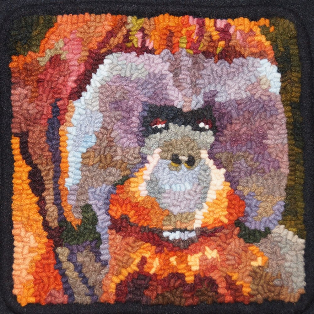 orangutang 2018. 6-cut wool on linen. Designed, dyed, and hooked by April D. deconick.