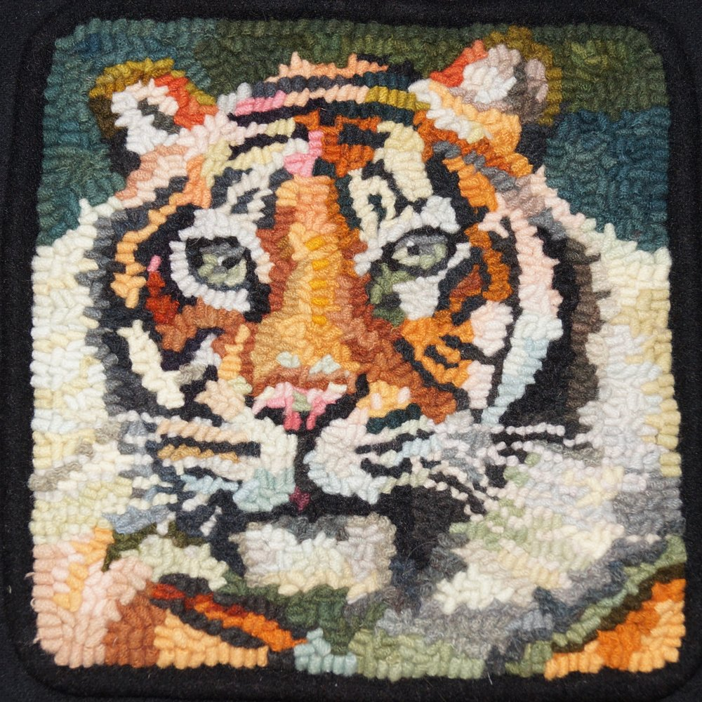 Tiger 2018. 6-cut wool on linen. Designed, dyed, and hooked by April D. deconick.