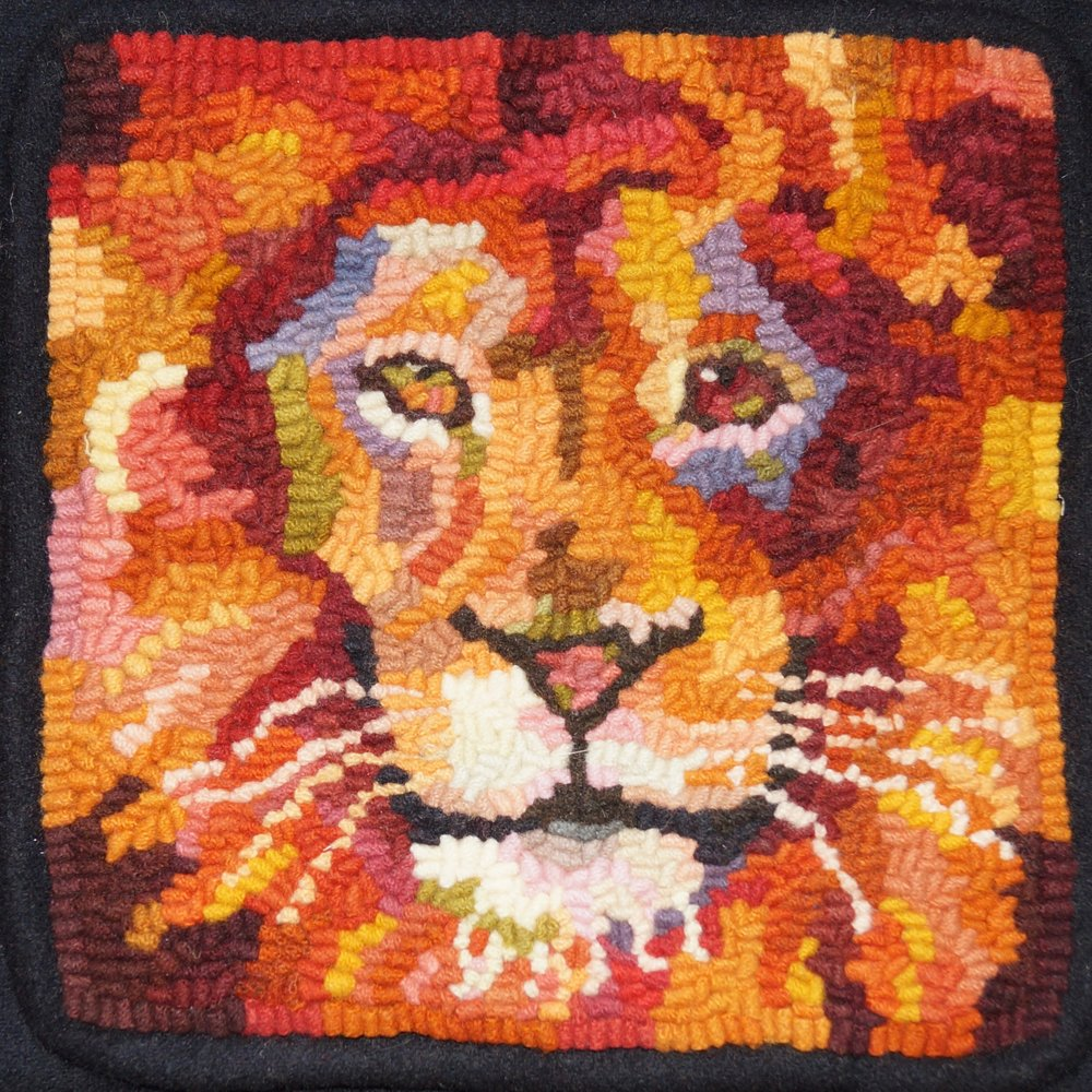 lion 2018. 6-cut wool on linen. Designed, dyed, and hooked by April D. deconick.