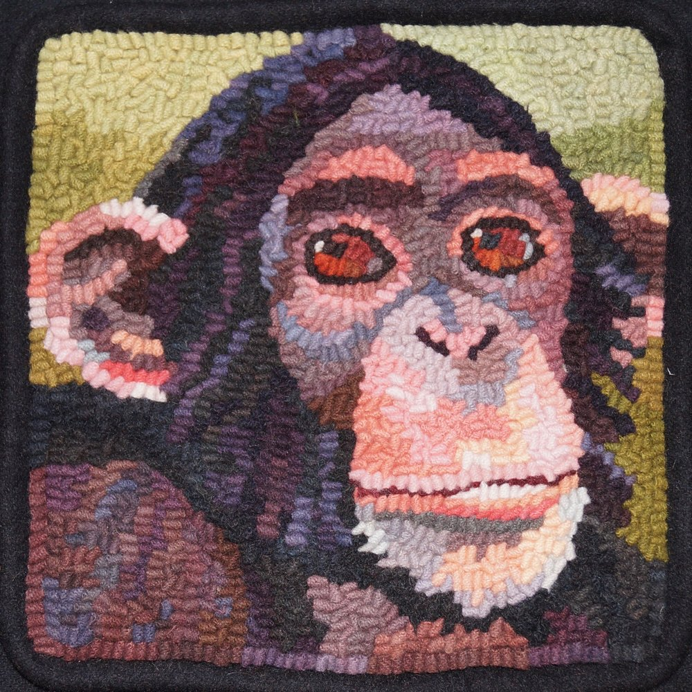 Chimpanzee 2018. 6-cut wool on linen. Designed, dyed, and hooked by April D. deconick.