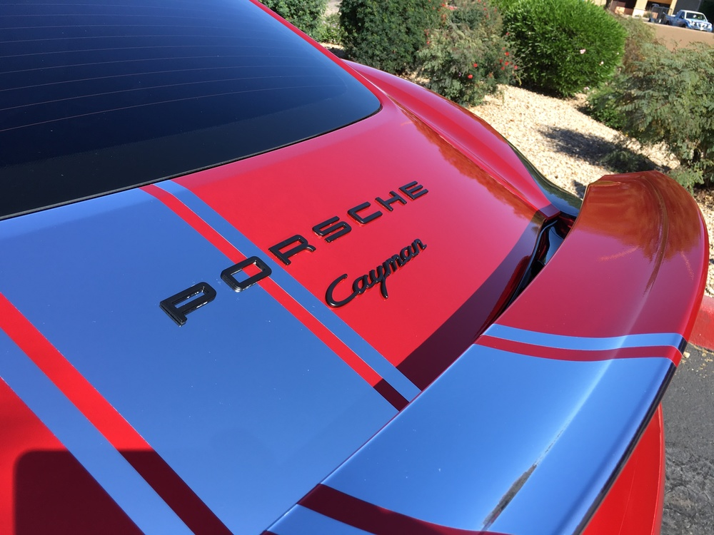 Porsche cayman in for a full avery red chrome vinyl wrap for Avery paint protection film