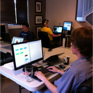 """Hard at work at Bracket Labs first office in Blakely's basement aka """"The War Room""""."""