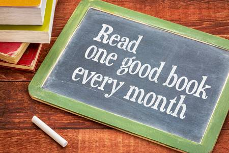 50275540-read-one-good-book-every-month-advice-or-reminder-on-a-slate-blackboard-with-a-white-chalk-and-a-sta.jpg