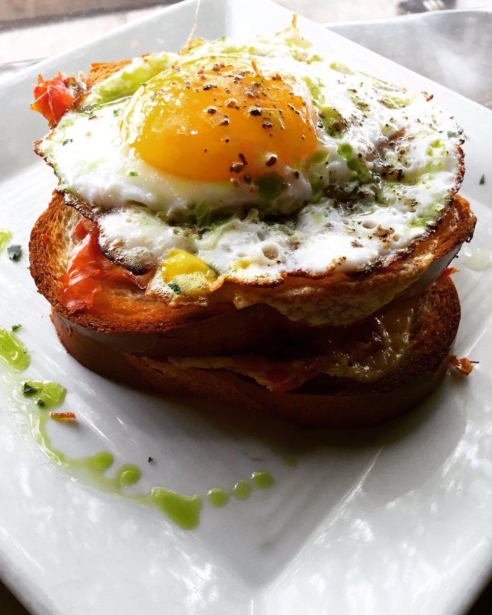 The Uitsmitjer -Sunny side duck egg, crispy prosciutto & gouda on brioche -Corner Charcuterie Bar, Baltimore, MD