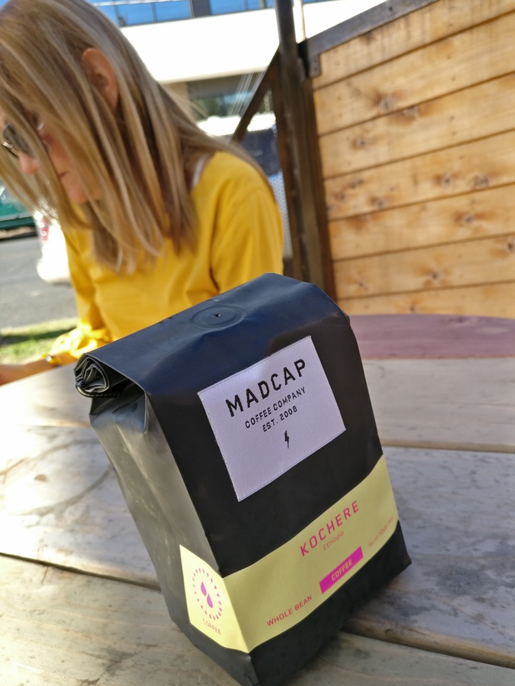 Kochere Ethiopia beans in a bag on my table. Madcap Coffee Company in Grand Rapids, Michigan roasted them on 11/14/16. How do you like that label?
