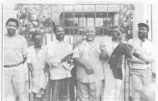 Society newspaper team after release from Shimo La Tewa maximum security prison. They were charged with 11 counts of sedition. From left to right: Senior Writer Laban Gitau, Assistant Managing Editor Mwenda Njoka, Editor-in-Chief Pius Nyamora, Mombasa politician Ahmed Salim Bahmariz (who raised bail to get Society Team out of prison), Nyamora Communications Director and Co-publisher Loyce Nyamora, and News Editor Mukalo wa Kwayera.