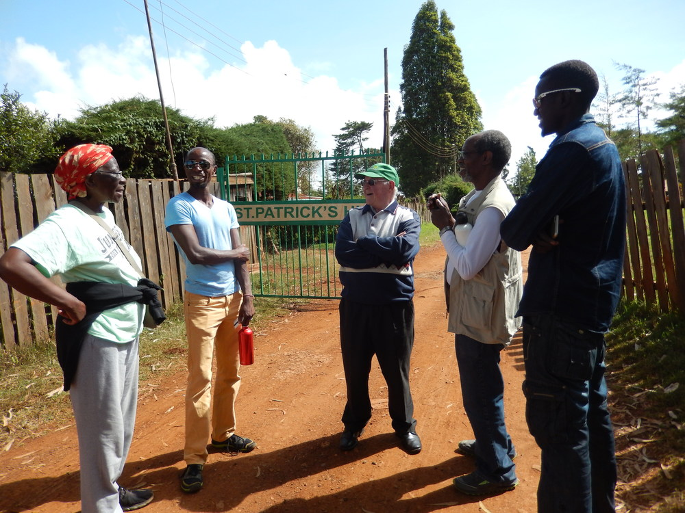 Timothy Limo, an elite Kenyan runner (far right) and Brother Colm O'Connell, legendary Kenyan coach (middle) took time out of their day to chat with us. Limo showed us around Iten Town and taught a very challenging core class to us and other runners.