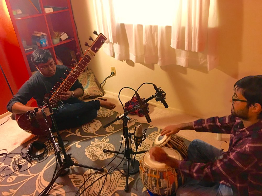 A behind the scenes pic from the recording session. The producer came down and tracked us in at my home studio. My friend Souvik Ghosh is on tabla.