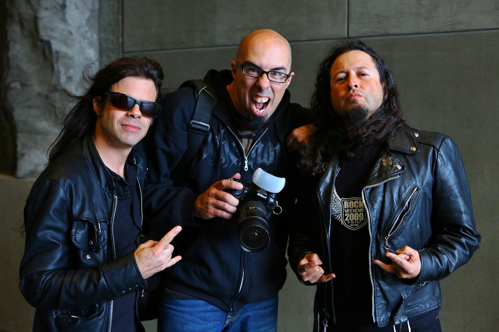 Todd La Torre, Seattle photographer Mike Savoia, and Michael Wilton.