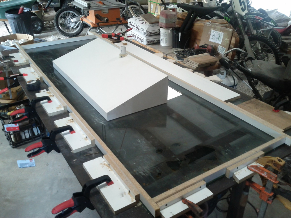 The sink void has been patched and sanded. The edges of the sink formwork are securely clamped to a giant sheet of glass to create perfectly straight and square edges and provide a very smooth surface from the beginning.